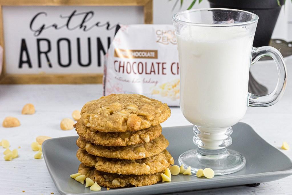 keto white chocolate macadamia nut cookies on plate with glass of almond milk