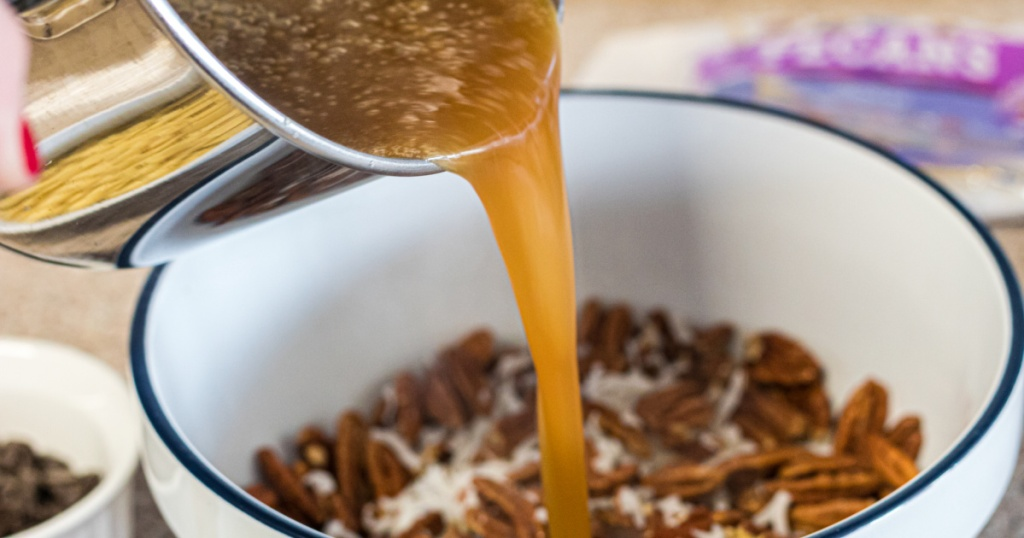 pouring buttered sugar into pecans