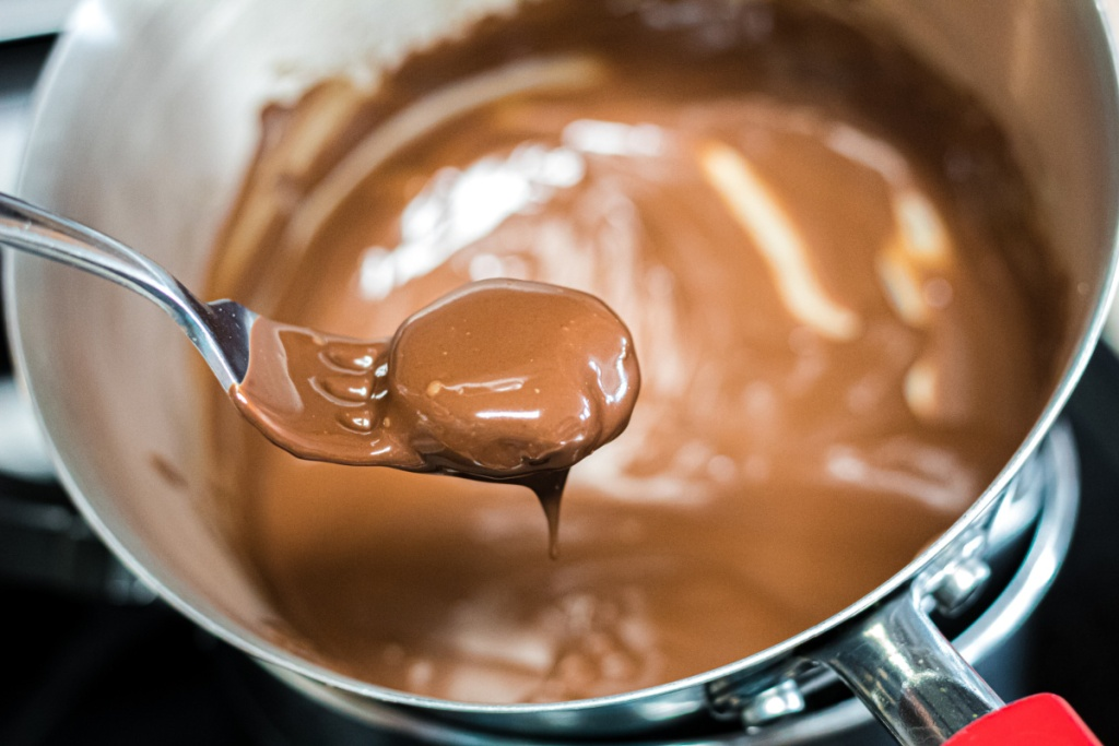 keto peppermint patty dipping into chocolate