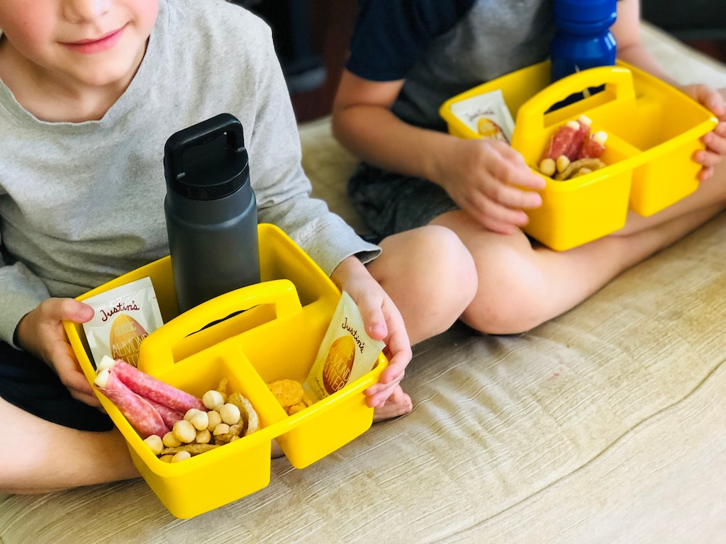 kids with containers filled with keto movie snacks