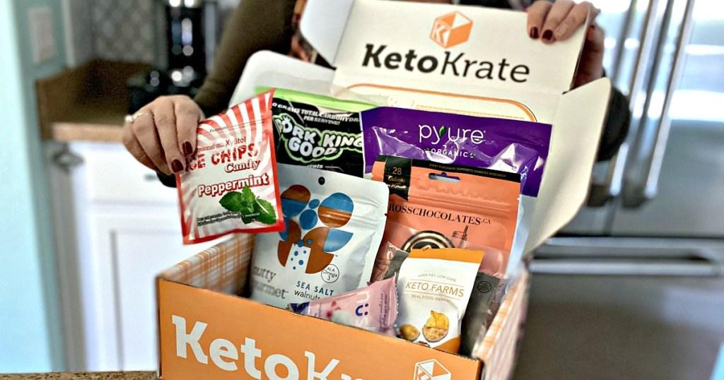 hands opening orange keto krate box