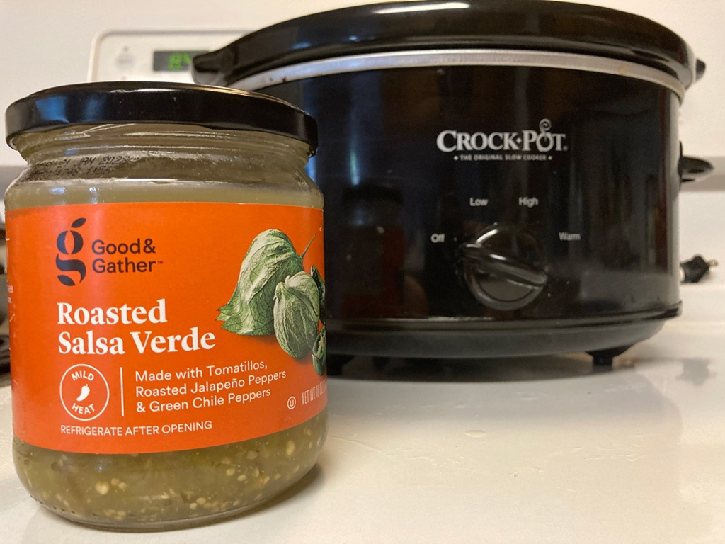 jar of salsa verde in front of crock pot