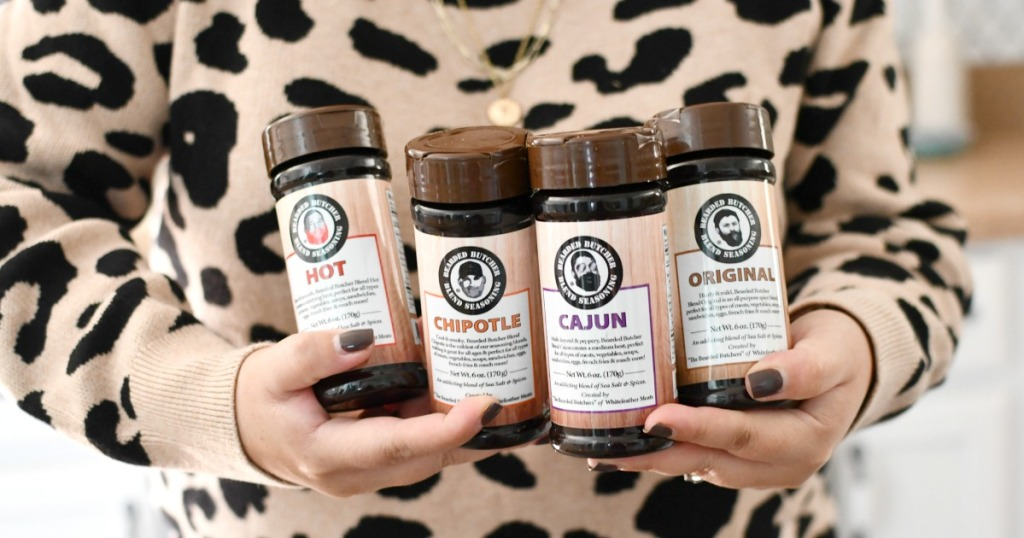 woman holding 4 bearded butcher seasonings