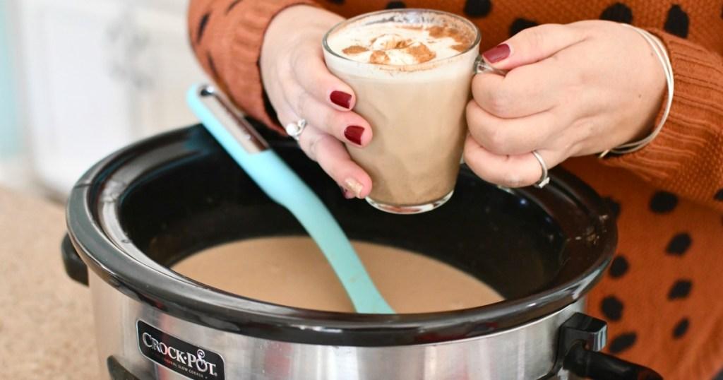 woman holding a crock-pot keto gingerbread latte