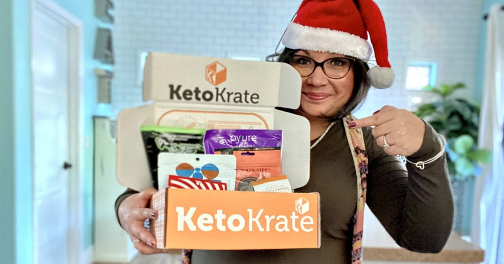 woman in santa hat holding a keto krate