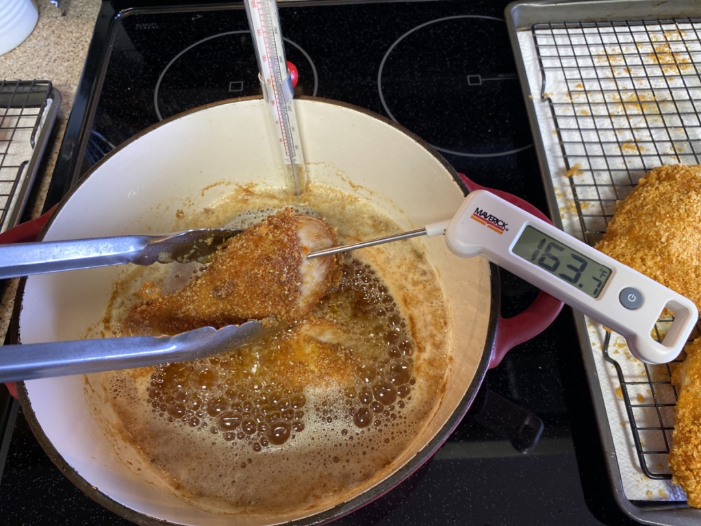 checking internal temperature of cooked chicken