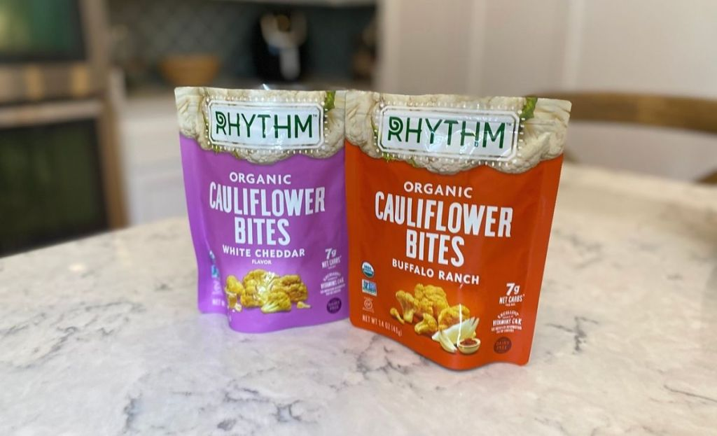 Bags of dried cauliflower snacks on a kitchen counter