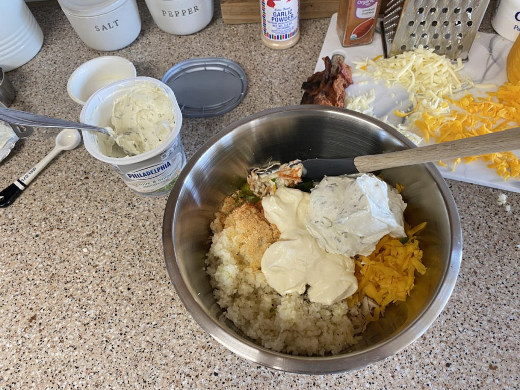 mixing chicken and cream cheese together