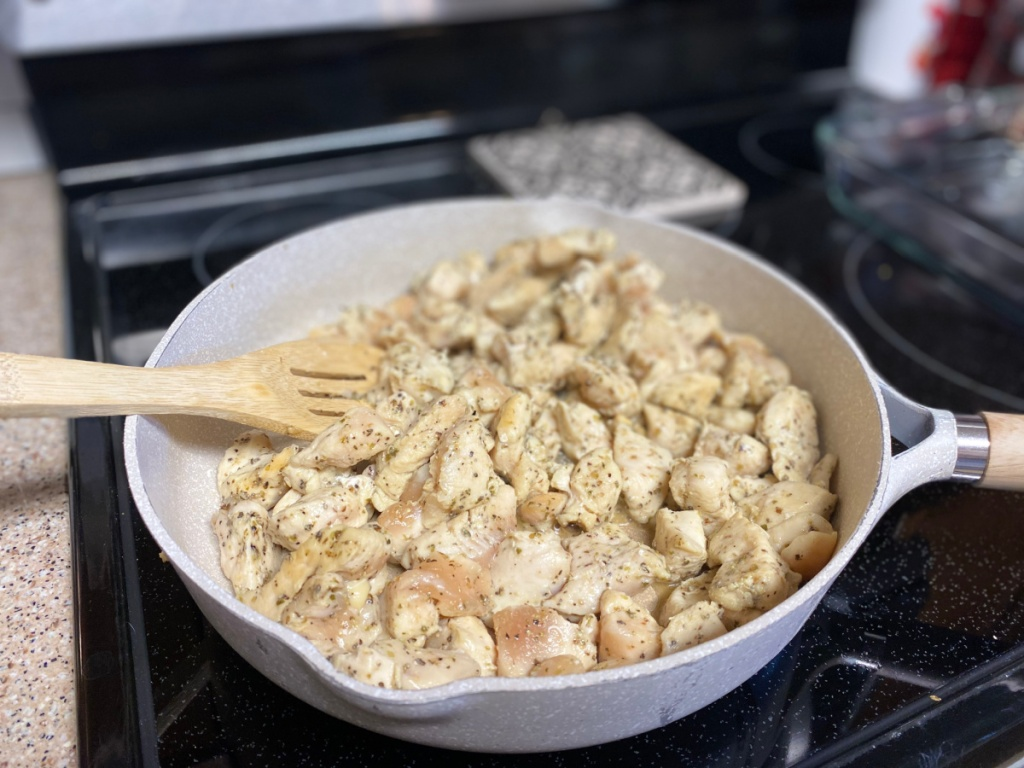 skillet with cubed chicken