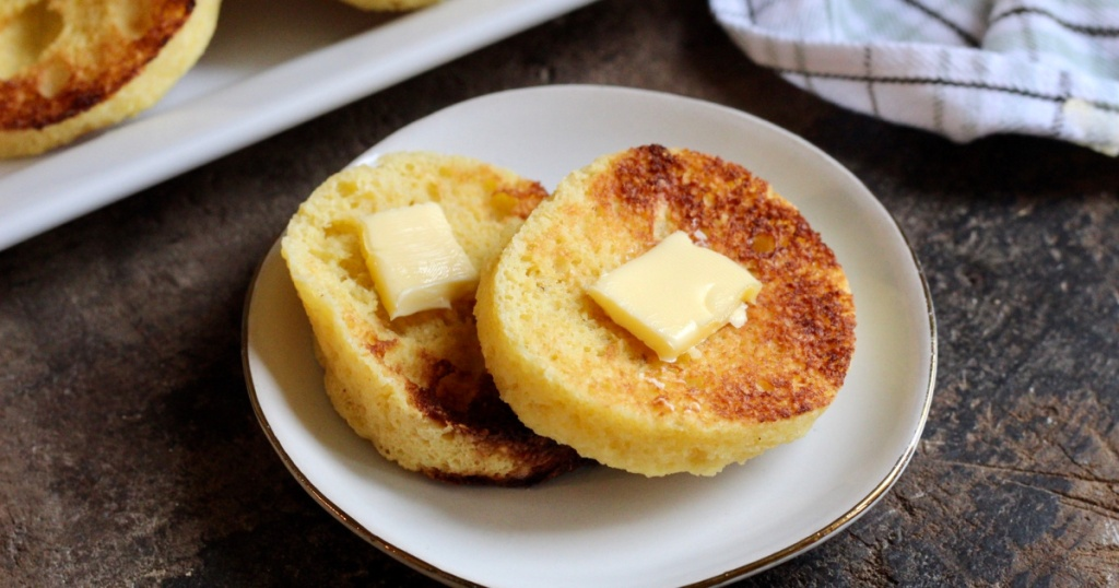 Keto English Muffins on a plate with a slice of butter