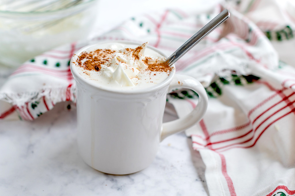 keto gingerbread latter in white coffee mug with whipped cream and cinnamon