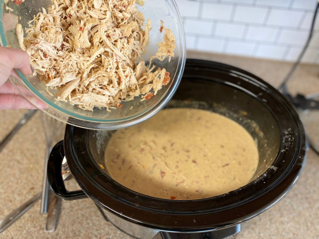 adding shredded chicken back to the slow cooker