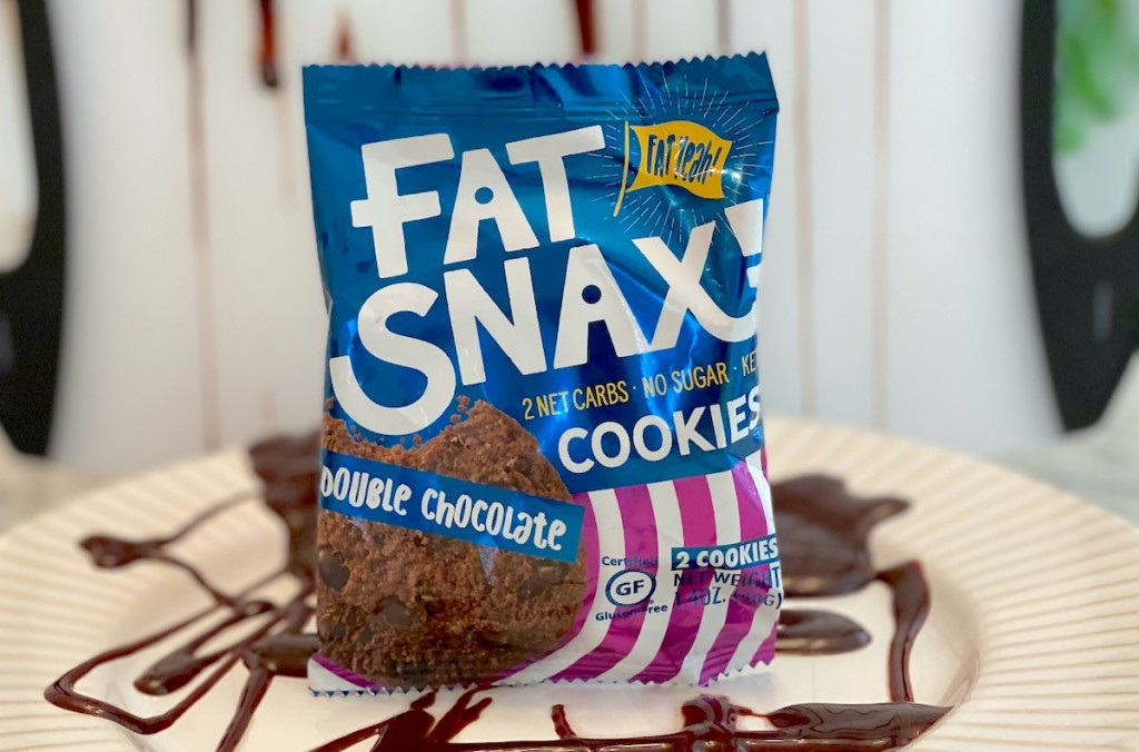 fat snax chocolate cookie on plate with chocolate sauce