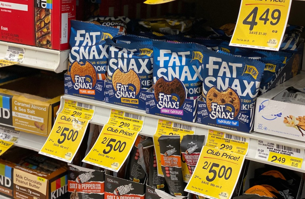 row of fat snax cookies on shelf with sale tags on shelf