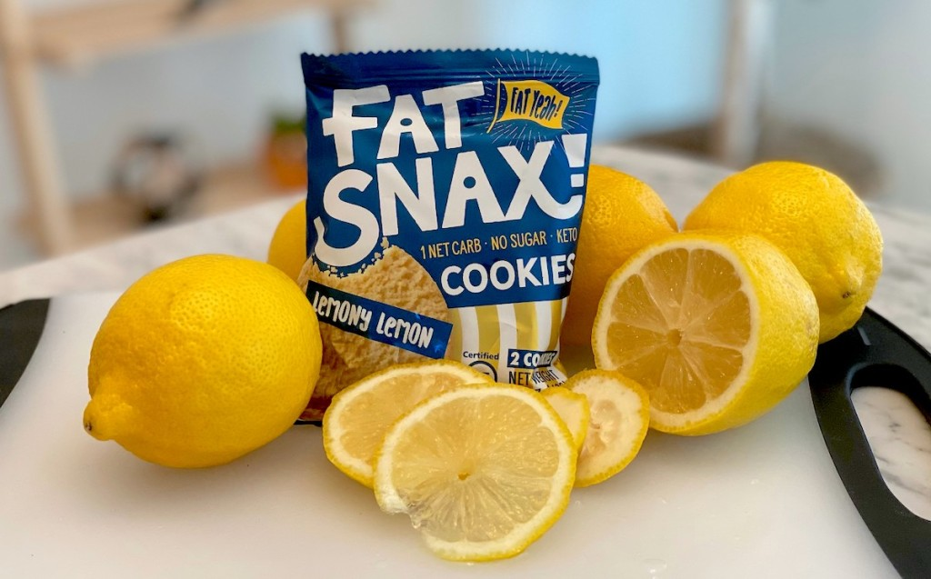 fat snax lemon cookie in bag surrounded by fresh lemons