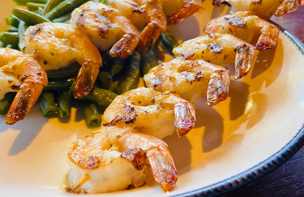 garlic shrimp skewers on plate