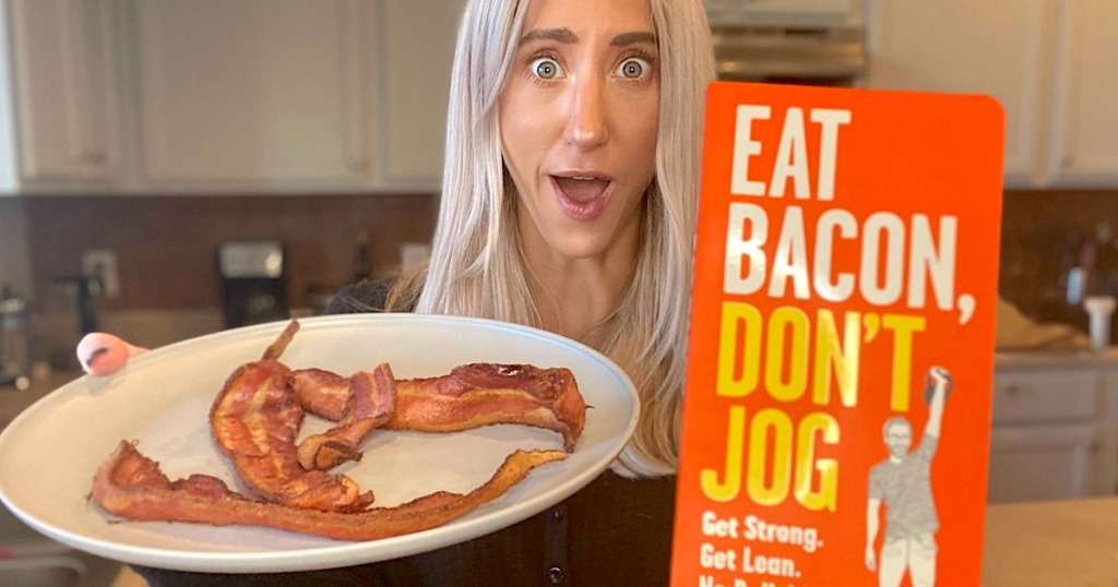 woman holding eat bacon dont jog book with white plate of bacon