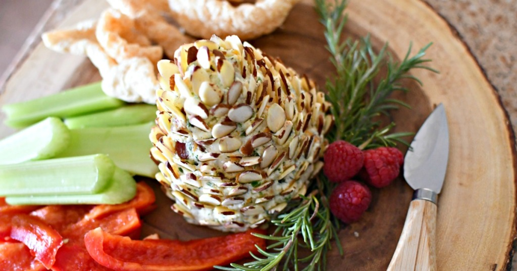pinecone cheese ball on a wood platter