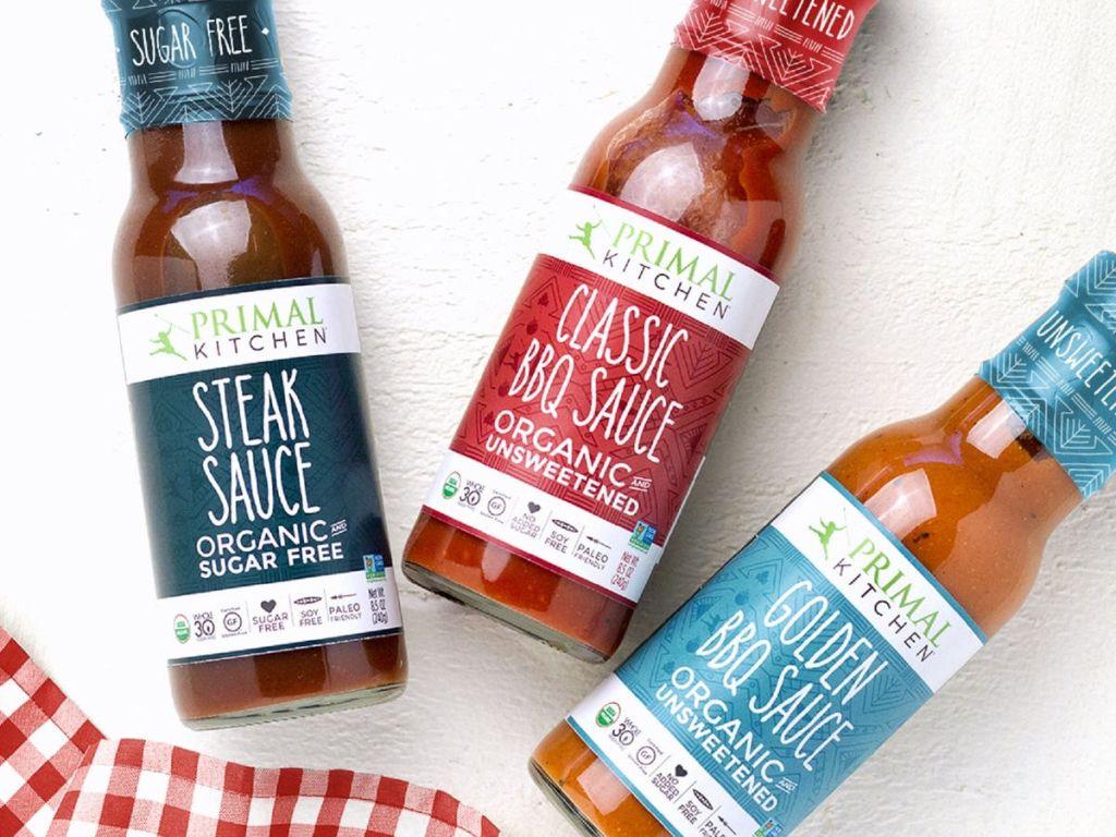3 bottles of Primal Kitchen BBQ and steak sauce