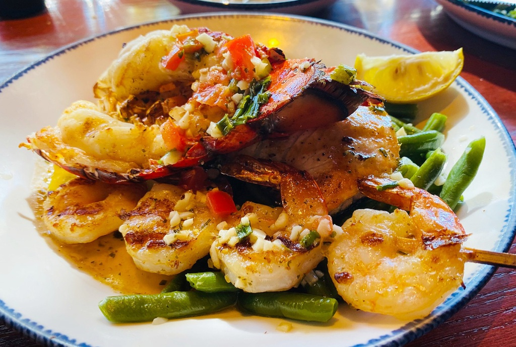 red lobster salmon shrimp on a plate