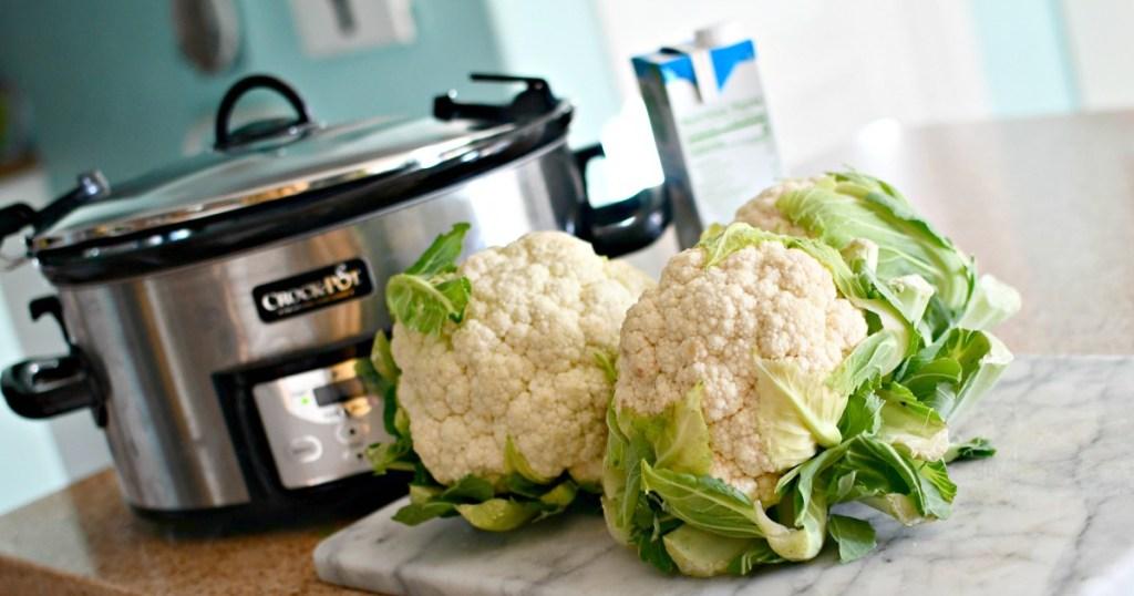 crock-pot and cauliflower heads