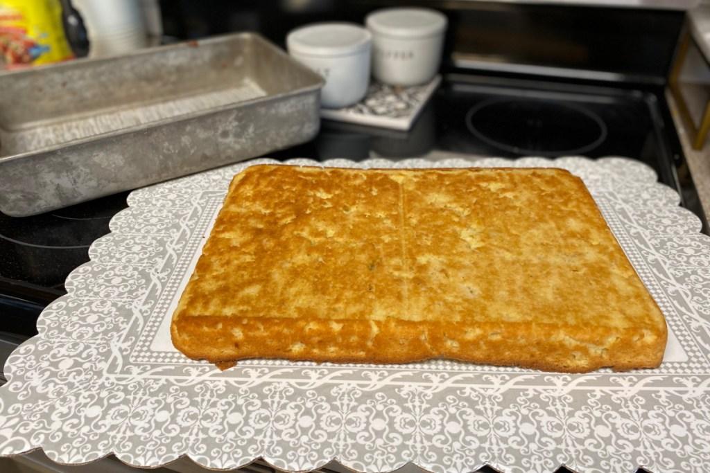 keto sheet cake on a cake plate cooling