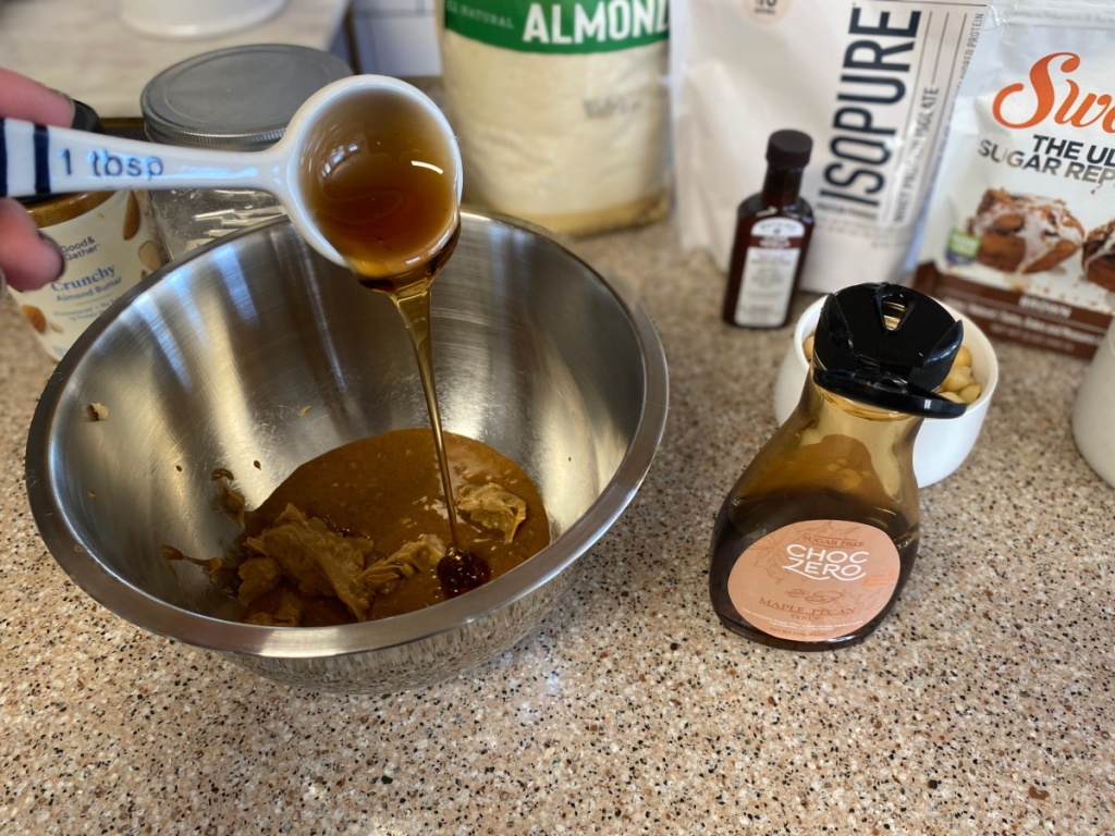 ChocZero syrup being added to mixing bowl