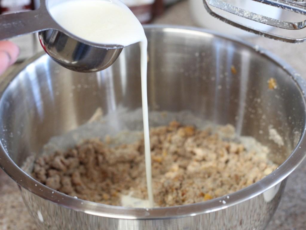 adding heavy cream to mixing bowl