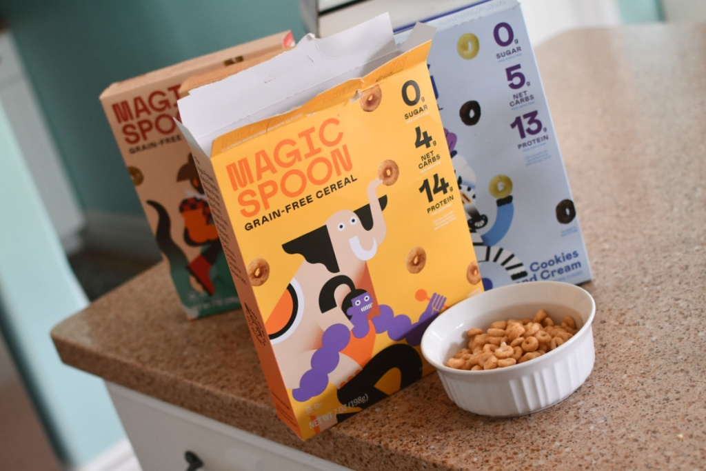 three cereal boxes and a bowl