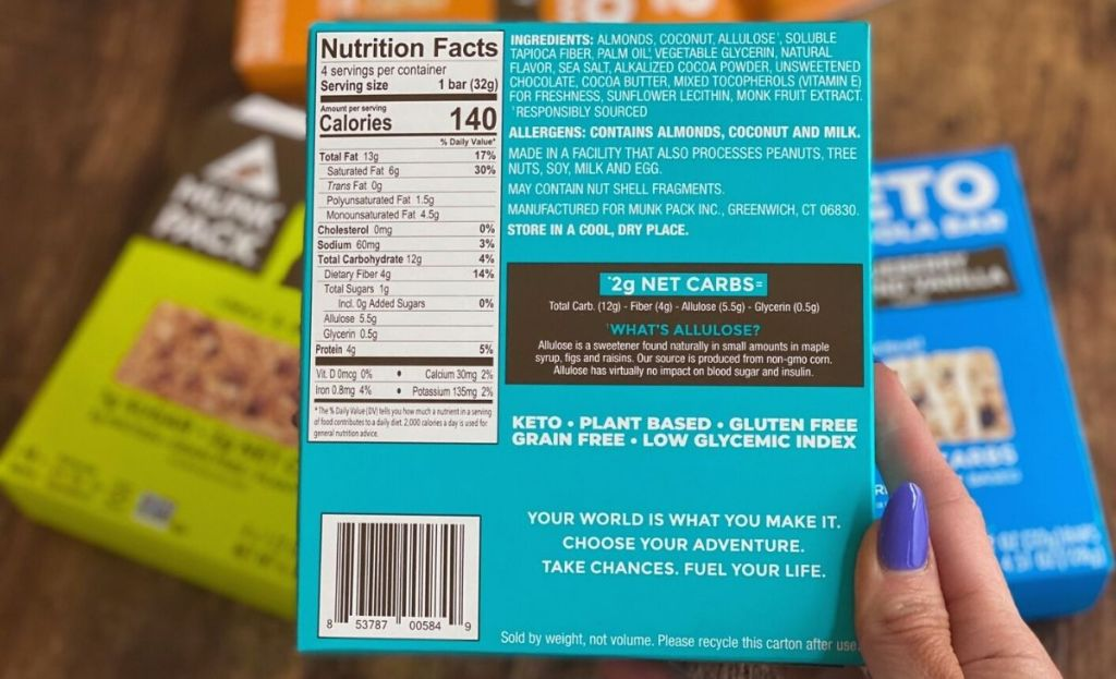 Holding a box of granola bars with nutrition info displayed