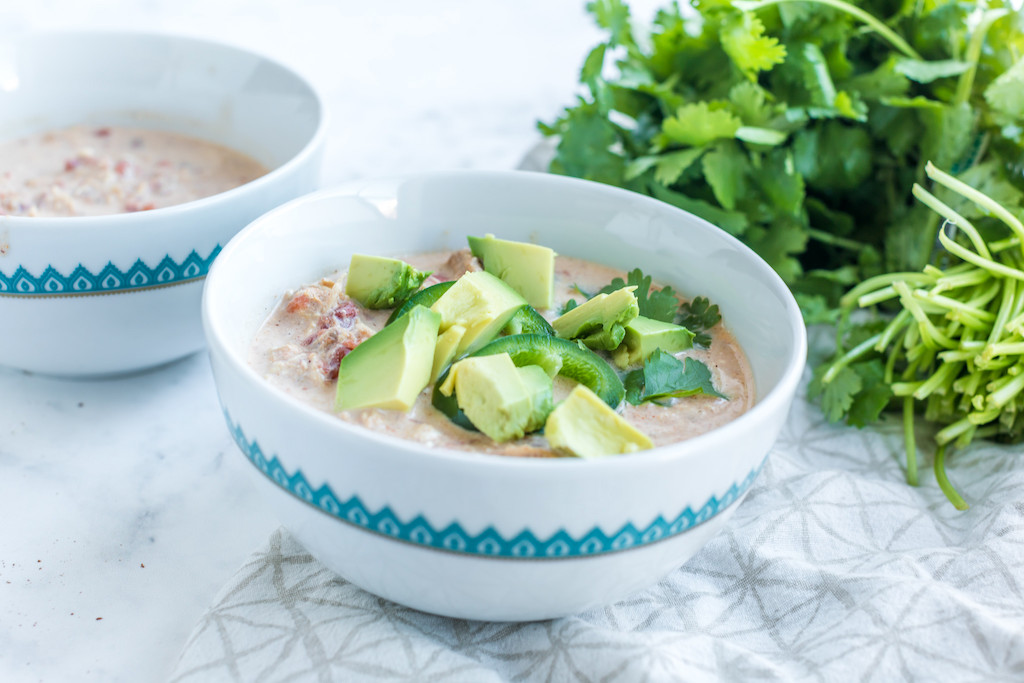 keto white chicken chili in bowl with avocados