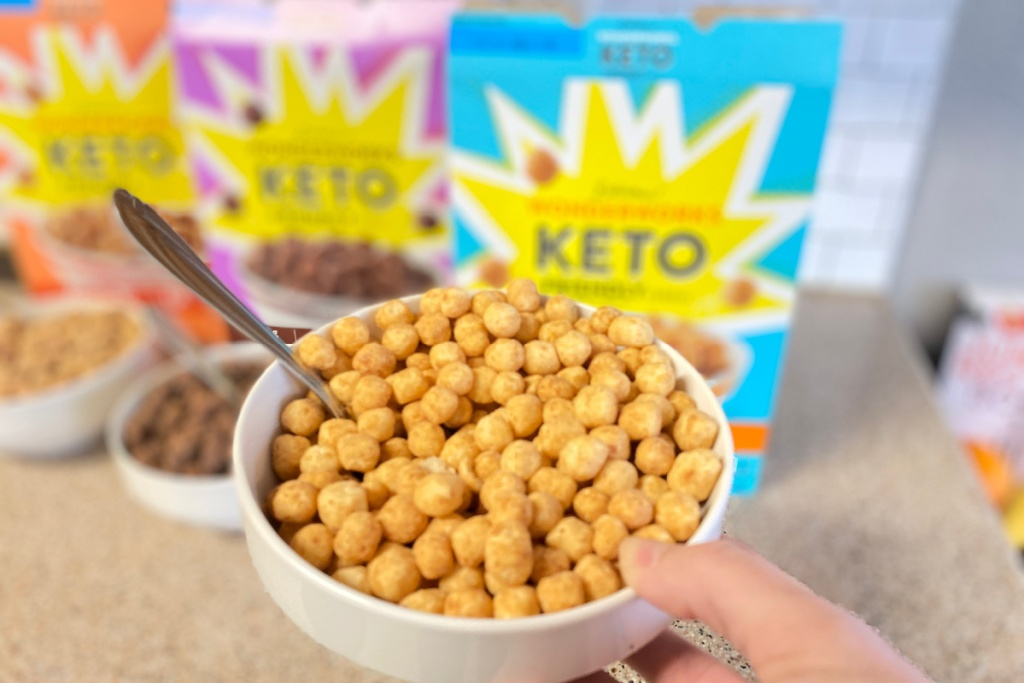 girl holding bowl of keto peanut butter cereal