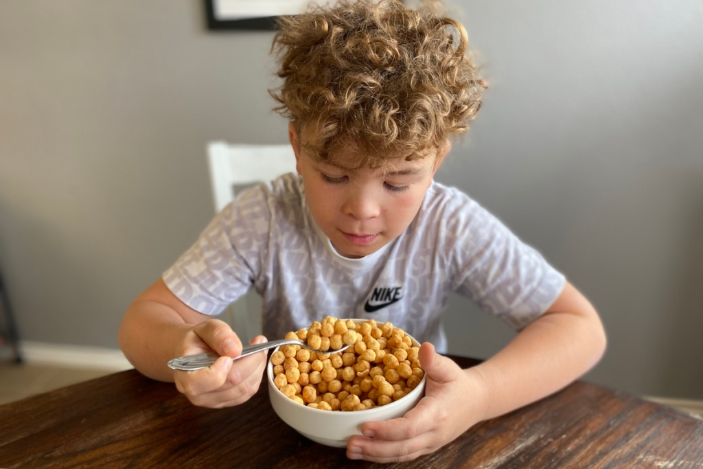 boy eating keto friendly cereal at the table