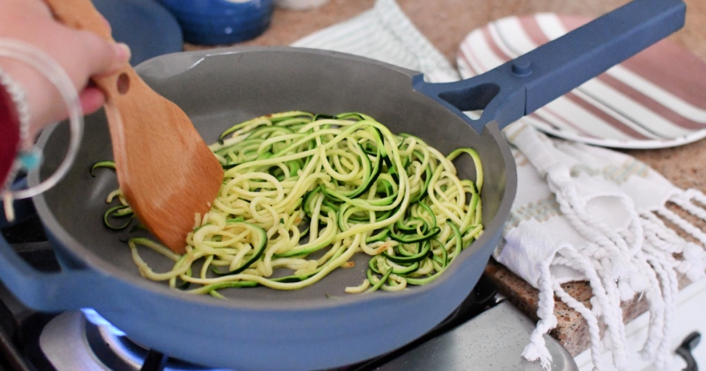 a frying pan with zucchini noodles