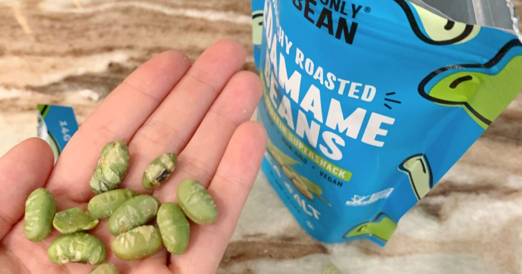 holding a handful of crunchy edamame beans