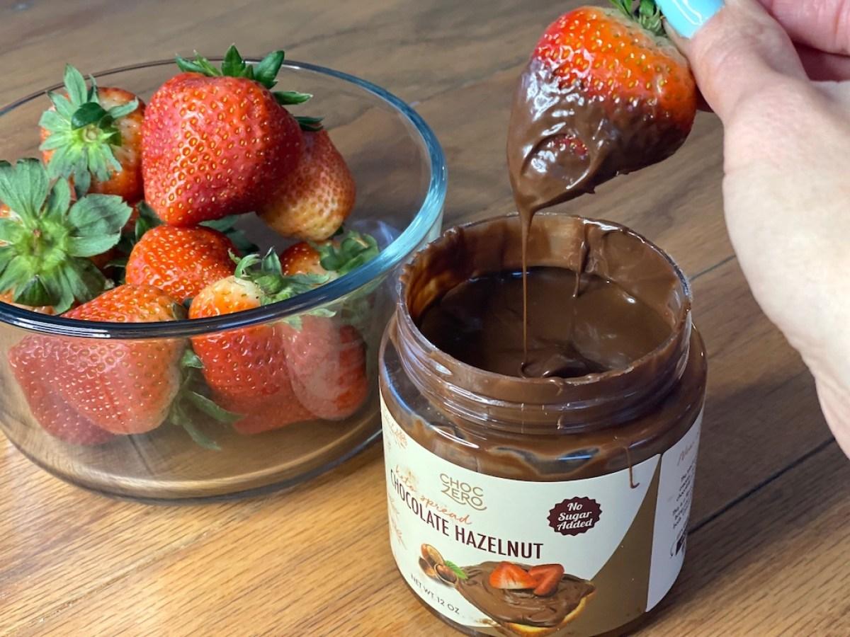 dipping strawberry in ChocZero Hazelnut spread