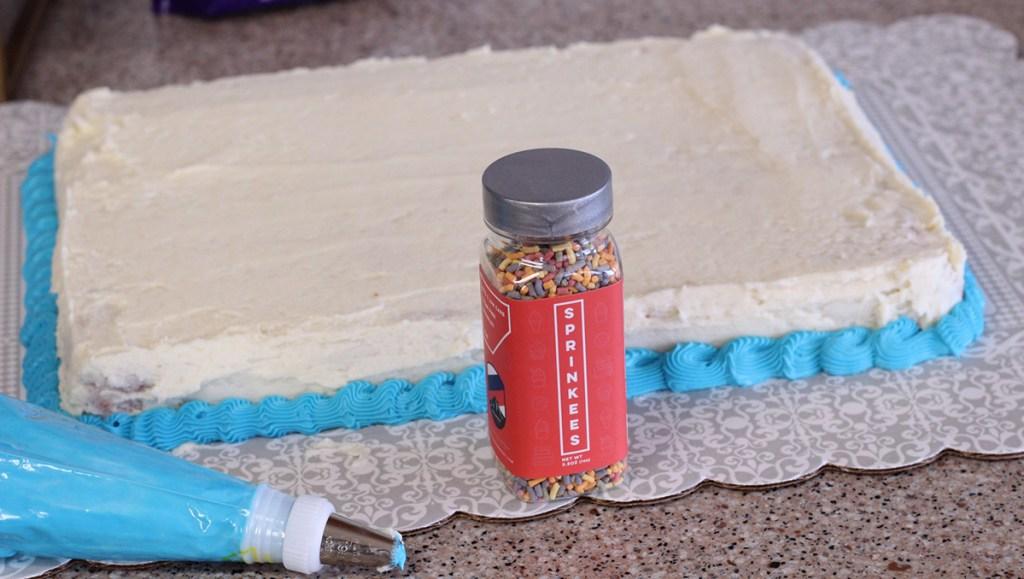 sprinkeez keto sprinkles in front of cake