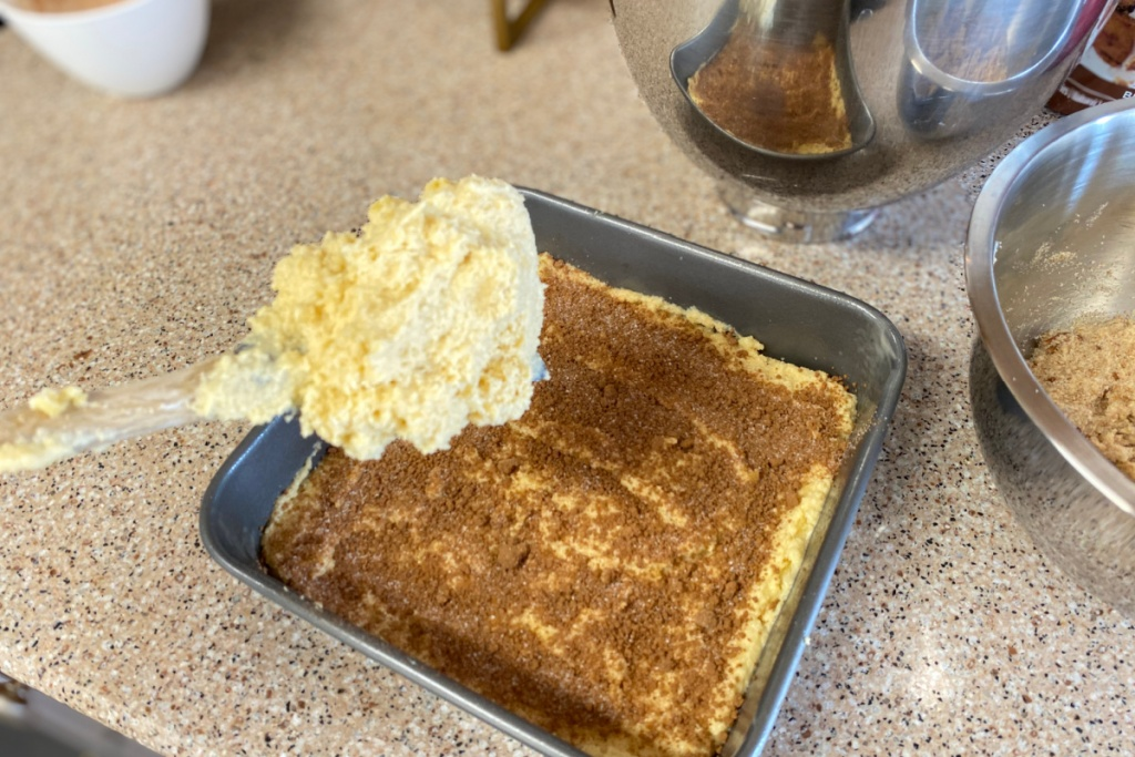 adding cake batter to pan