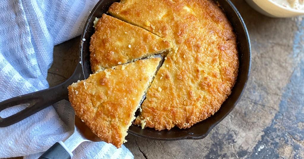 keto cornbread slice in a cast iron skillet