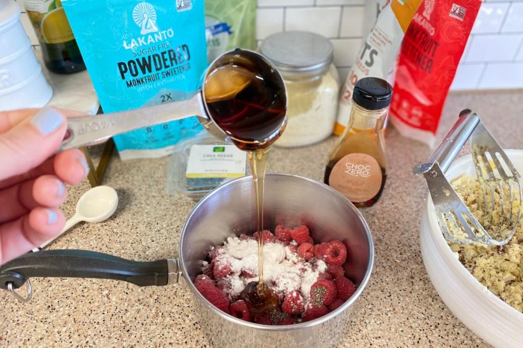 adding maple syrup to saucepan