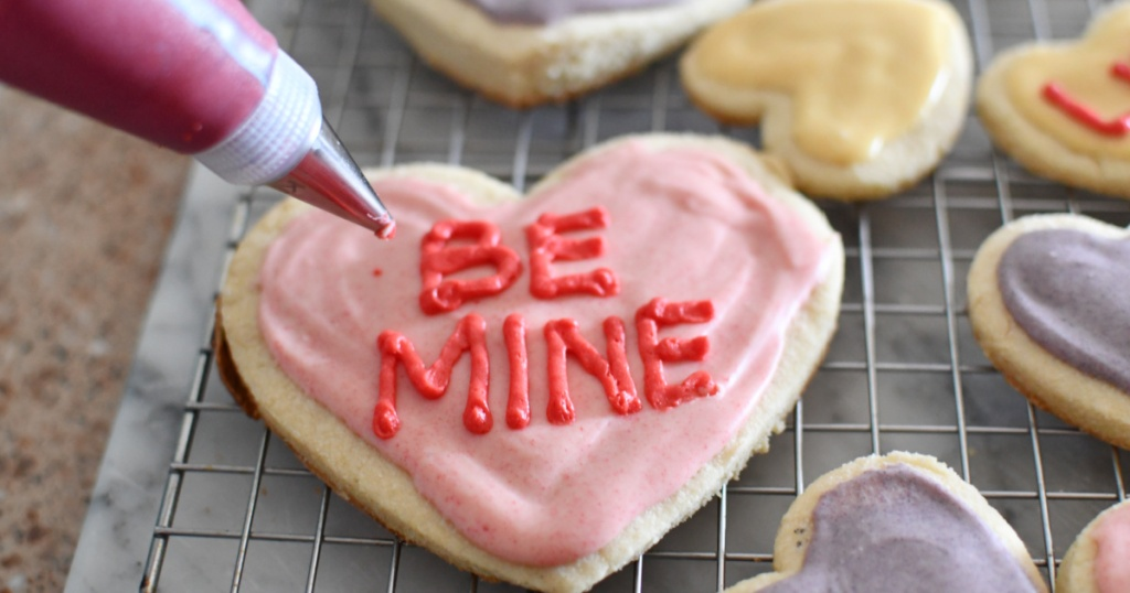 piping be mine onto keto conversation heart cookies