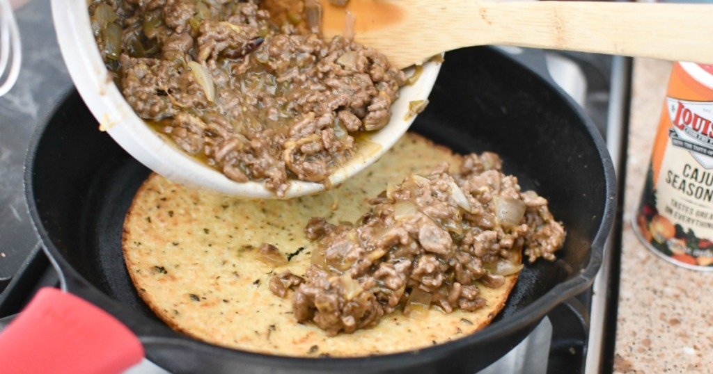 topping keto crust with ground beef mixture