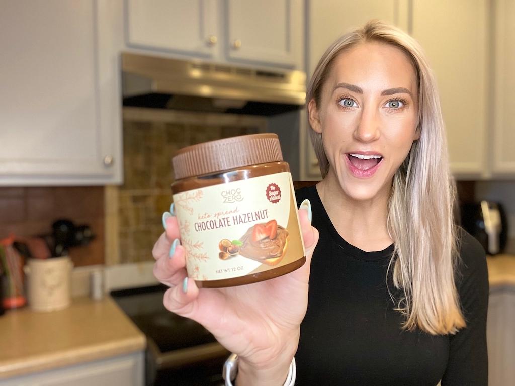 woman holding ChocZero keto chocolate hazelnut spread