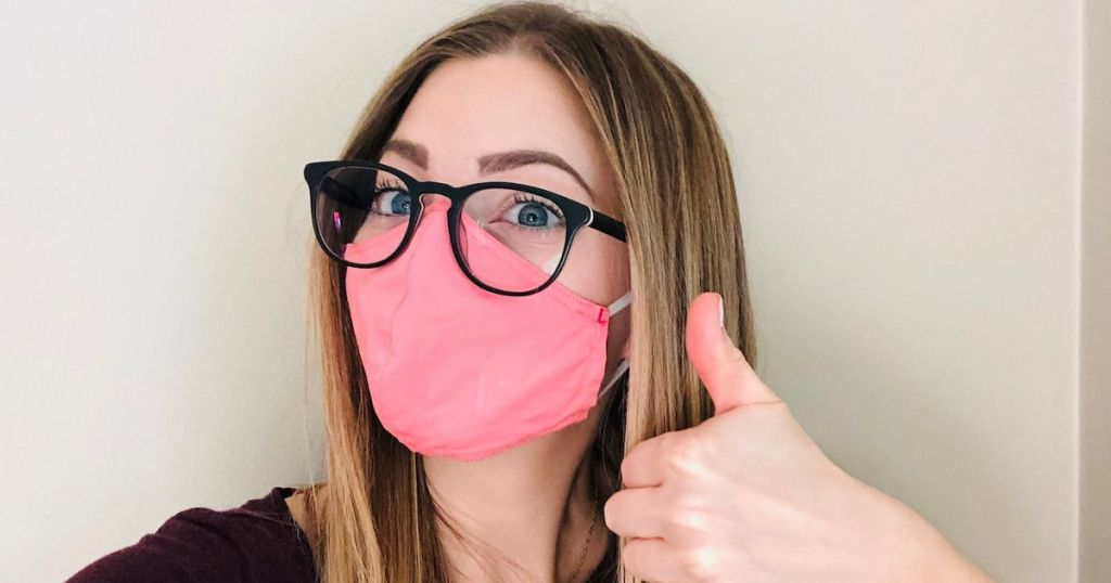 woman wearing mask and glasses