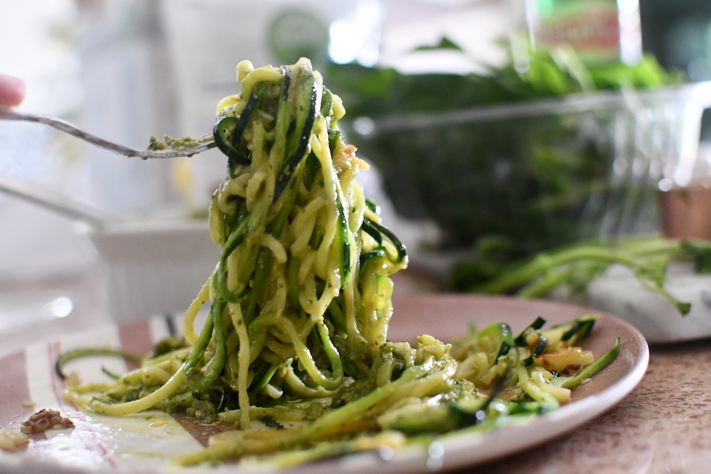 zoodles with pesto on fork