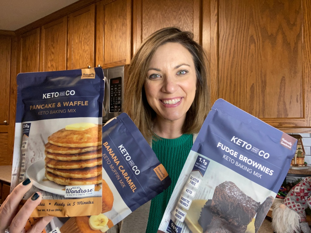 girl holding keto and co. product