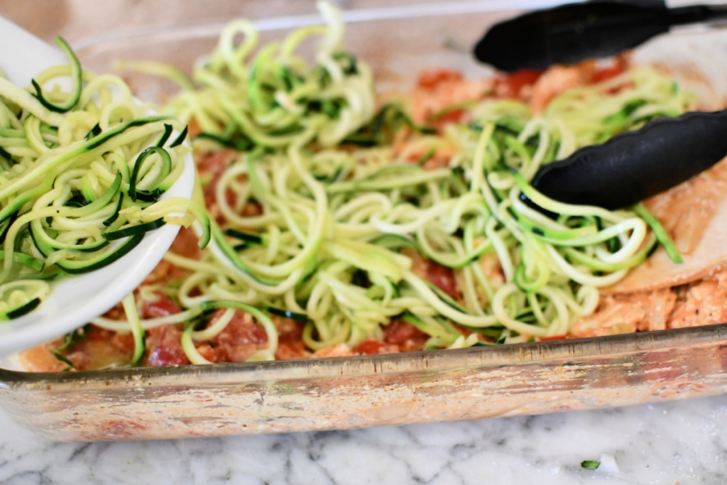adding zoodles to pasta