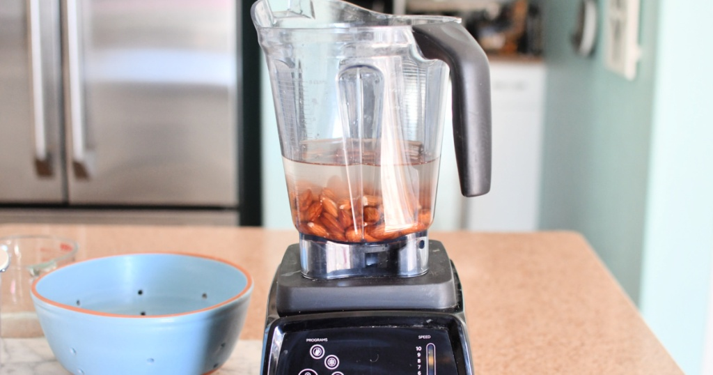 learn how to make almond milk by blending almonds with water in a vitamix