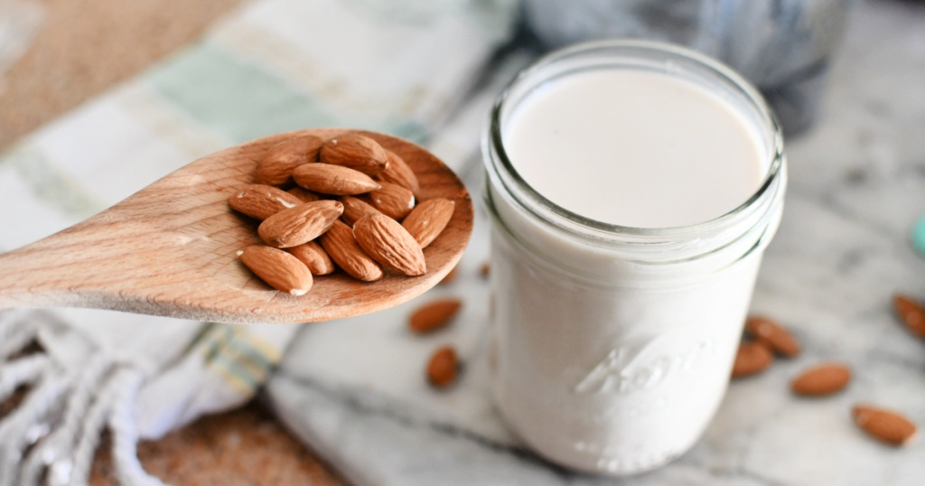 jar of homemade keto almond milk next to almonds