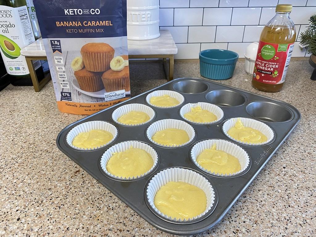 muffin tin with keto and co keto baking mix banana caramel muffins